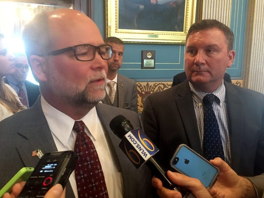From left, Senate Majority Leader Arlan Meekhof, R-West Olive, and Sen. Phil Pavlov, R-St. Clair, talking to reporters about a plan to shift new teachers from a pension plan to a 401 (k) type plan. This was taken at the state Capitol Tuesday, May 23, 2017.