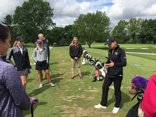 World Golf Hall of Fame member Annika Sorenstam offers advice to Waukee girls' golf team members Tuesday as part of a surprise clinic at Des Moines Golf and Country Club. Sorenstam was at the course as part of preparations for her role as the captain for Team Europe in August's Solheim Cup.