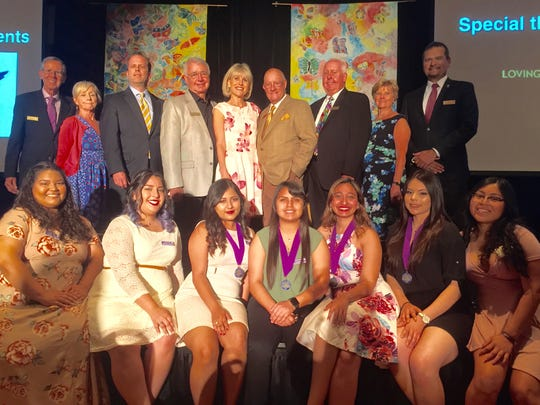 Pictured (standing left to right) are: board members Leon Bennett, Kathy Felci, Robert Evans, John Shimer, Gale Hackshaw, Bill Powers, Donald Griffith, Susie Harvey and Dan Martinez. Seated (left to right) are Ophelia Ambassadors Yareli Zamora, Kimberly Cazarez, Nathalia Casillas, Eva Murillo, Rebecca Henein, Jennifer Rocha and Emily Rumaldo.