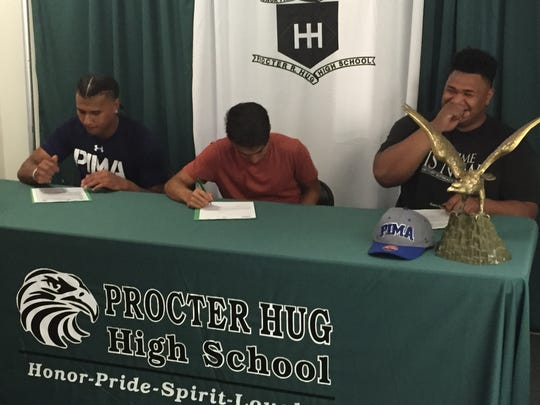 Left to right, Sam Moala, Jason Dubon, and Junior Pousima signed the Letters-of-Intent in a ceremony Tuesday at Hug.