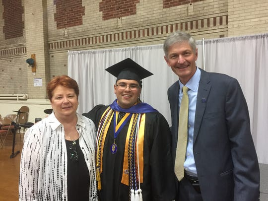 Ralph Noriega celebrates his graduation with GCU's Evelyn Quinn and University president Joseph Marbach. Noriega begins work Friday as an EMT and public safety employee in Bradley Beach. He heads to the police academy in January.