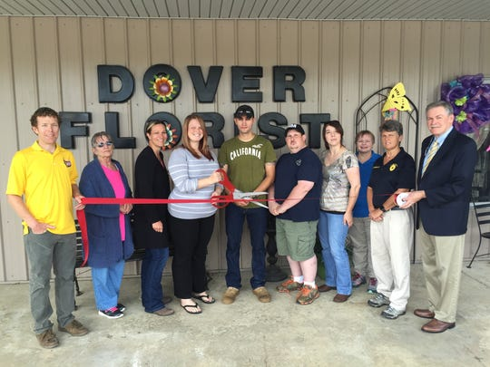 Christine and Brandon Yers prepare to cut a ribbon at their business, Dover Florist and Gifts with the help of Stewart County Chamber of Commerce members,