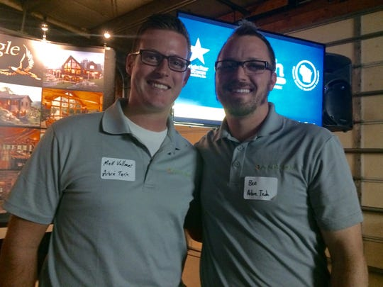Matt Vollmer and Ben Meyers won $2,000 for their company, Abre Tech, during the HATCH business contest Wednesday at Golden Eagle Log Homes in Wisconsin Rapids.