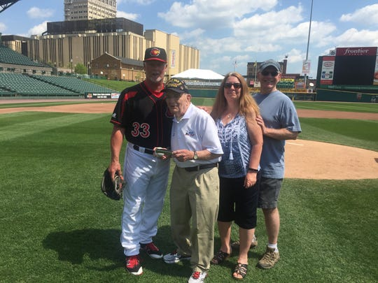 Red Wings pitching coach Stu Cliburn, World War II veteran Peter DuPre, his daughter Mary Ann and son Mike, after Pete's pitching lesson at Frontier Field.