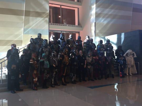 Mandalarian Mecenaries pose for a group picture at