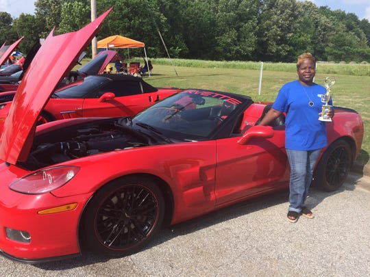 Coretta Jernigan poses with her car after winning Top 50 in the Corvette Show at the Exit 56 Blues Fest in Brownsville, Tenn. on May 27, 2017.