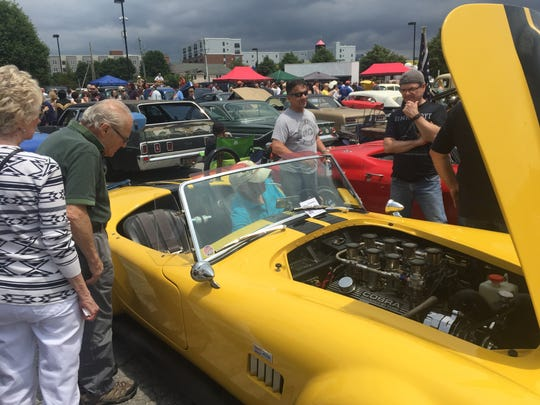 Wilmington's Jim Stern (in the driver's seat) answers questions about his replica 1966 AC Cobra at the 7th Annual Wilmo A Go Go Car Show Sunday.