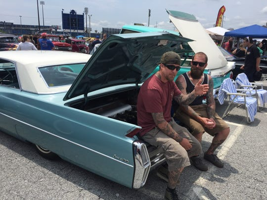 Brian Carden (left) and Ryan McGonigal sit in the trunk