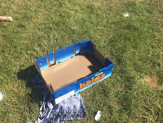 Trash is scattered across the infield at the Indianapolis
