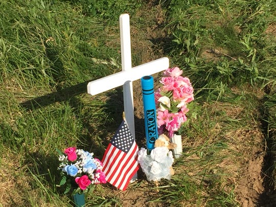 A memorial set up June 1, 2017 at the site along the Muncie Bypass where 6-year-old Taelyn Ann Marie Woodson was killed in a crash of her family's van two days earlier.