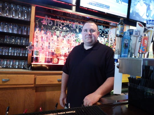 Tracy Barkalow, the co-owner of Sonny's Tap, is shown in his bar on May 26, 2017. He plans to expand into the space that once housed Taste of Chine order to make a sell food at Sonny's.
