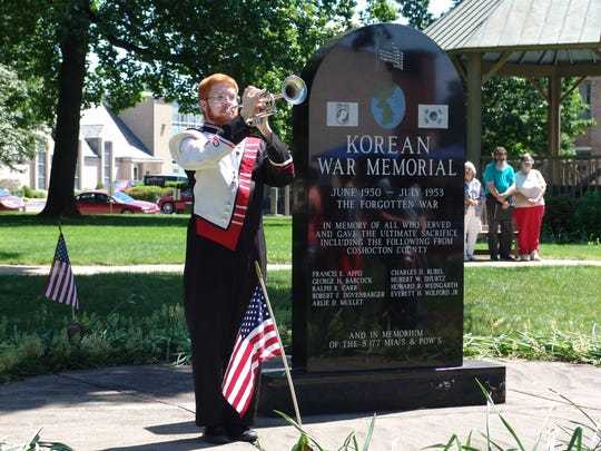 Jacob Heading plays Taps at the Korean War War Memorial on the Coshocton Court Square for past Memorial Day services in this Tribune file photo.