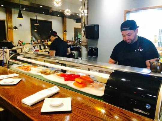 Dao chefs working at the sushi bar.