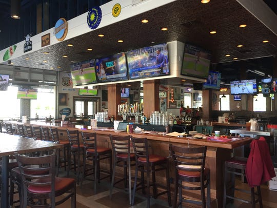 Wild Wing Cafe has a 34-seat bar and features 66 types of beer, 30 on tap.