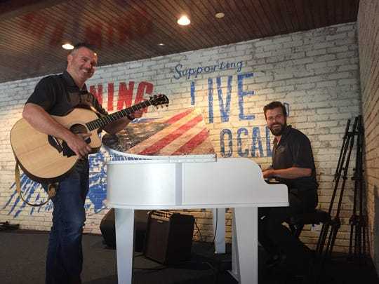 Jon Garrett of Royersford, Pennsylvania, director of marketing for the new location, takes over the piano at Wild Wing Cafe in Barrington, while Chief Operating Officer John DeLucia takes the lead on guitar. The venue will offer live music on weekends.