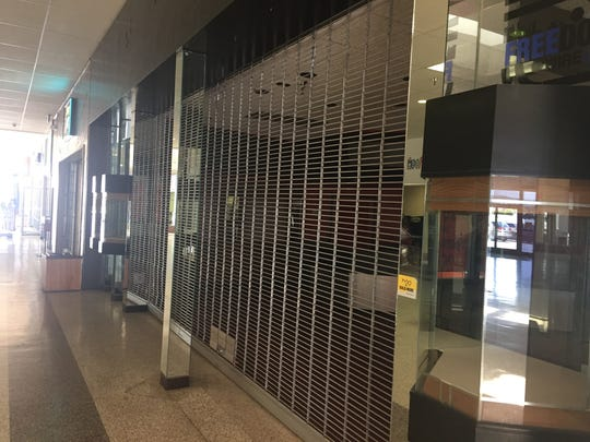 A shuttered storefront sits vacant at the Carlsbad Mall.