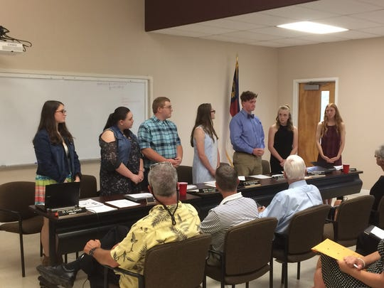 FFA students Kendra Reece (from left), Alyssa Green, Chase Askew, Grace Massey, Ian Smith, Elizabeth Leslie and Lacey Shelton make a presentation about genetically modified organisms.
