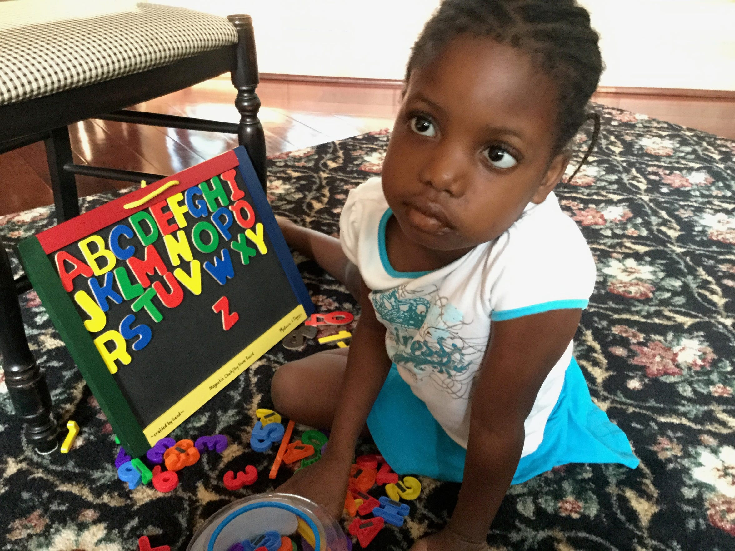 Chika, 5, who was homeschooled, practices her spelling in the Albom family home, just after her first brain surgery in the summer of 2015.