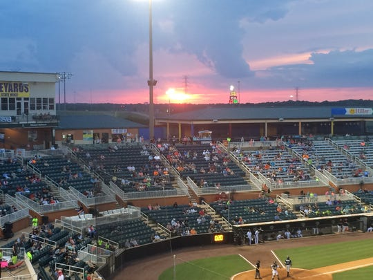 The sun sets in the distance behind the stands on the third-base side of The Ballpark at Jackson last year.
