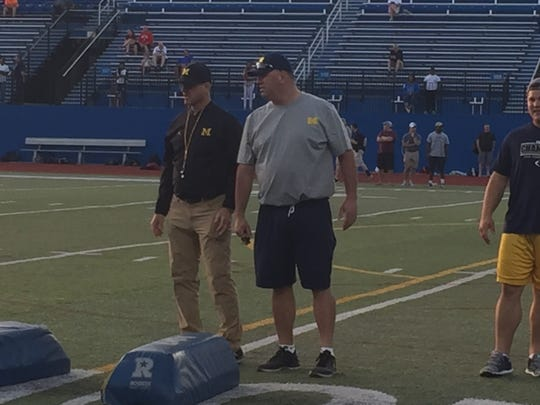 Michigan coach Jim Harbaugh watches during Friday's satellite camp in University Heights, Ohio.
