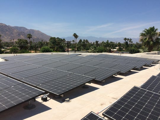 Solar panels on top Camelot Theatres in Palm Springs cool the building while drawing less energy during peak hours.