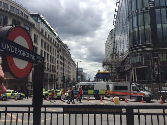 Police vehicles blocking access to London Bridge.