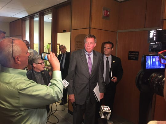 Michigan State University Board Chairman Brian Breslin addresses the media Monday following a closed-door meeting on the school's football program.