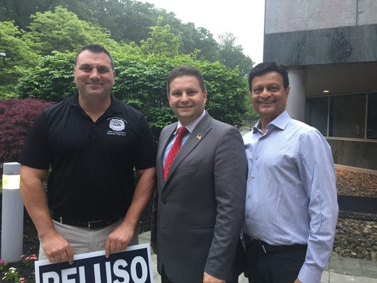 Parsippany mayoral candidate Robert Peluso, center,