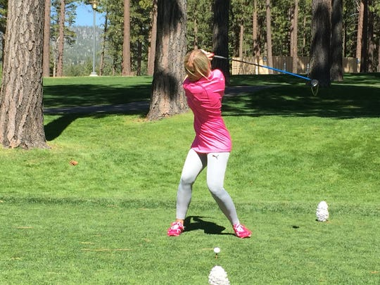 Blair O'Neal hits a drive Tuesday at Edgewood Tahoe. She is one of four women in the ACC celebrity golf tournament this summer at Edgewood.