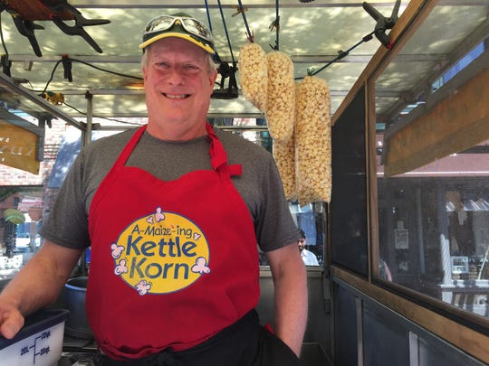 Paul Buschner runs the A-maize-ing Kettle Korn cart