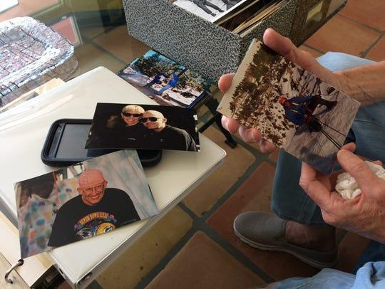 Janice Kleinschmidt shows photos of her former husband,