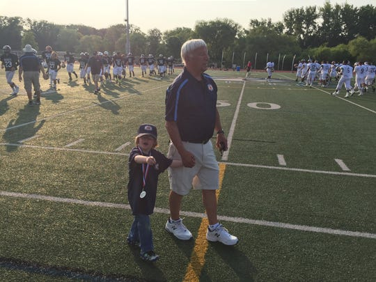 Former high school state and Section V football chairman Dick Cerone with a honorary team captain before the 2015 Eddie Meath All-Star Football Game.