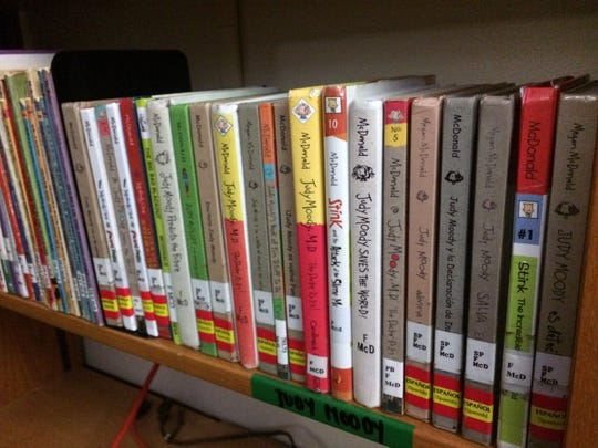 The bilingual books at the library at Tank Elementary in Green Bay are identifiable by red bands.