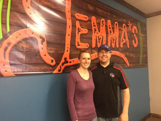 Brittney and Justin Paiser stand in front of a newly