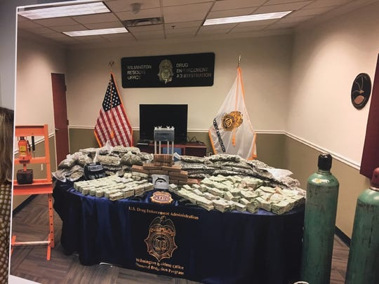 Drug enforcement authorities on Wednesday displayed photos of seized assets associated with a recent drug trafficking indictment.
