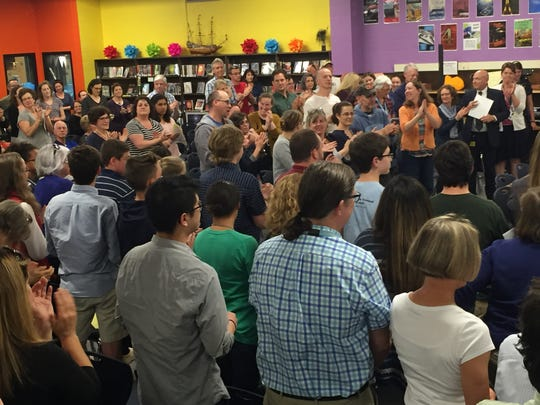 A standing ovation followed the School Board's decision to approve Wolves as a mascot for South Burlington schools on June 7, 2017 at Tuttle Middle School.