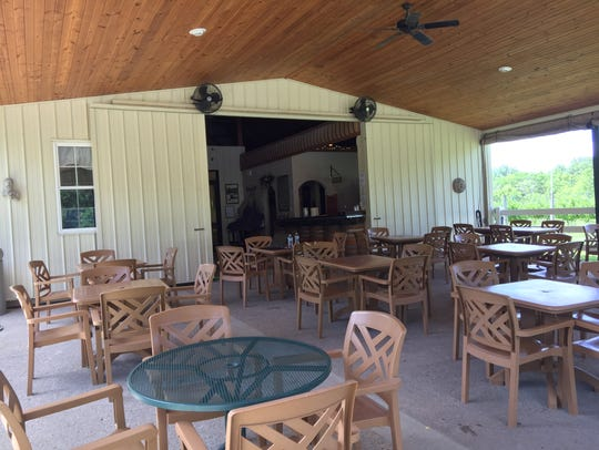 Guests at Harmony Hill Vineyard grab a table on the