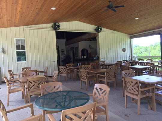 Guests at Harmony Hill Vineyard grab a table on the patio or spread a blanket or set up chairs on the lawn for an afternoon and evening of music and wine.