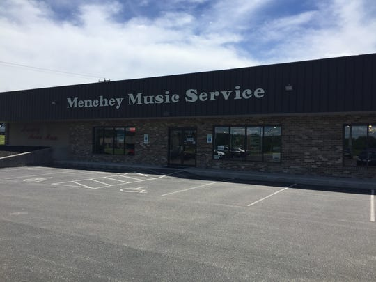 Menchey Music Service will place its building on Wetzel Drive for sale in anticipation of moving to a larger location in the Hanover area.
