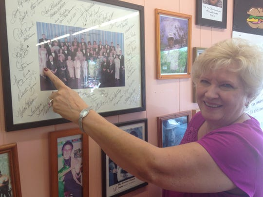 Ava Barber points to her picture in a 2001 reunion photo of the cast of The Lawrence Welk Show.