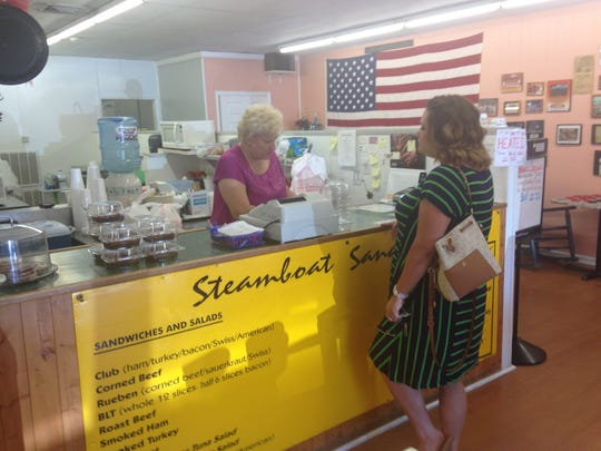 Ava Barber takes an order from a customer last week at the Steamboat Deli in Powell.