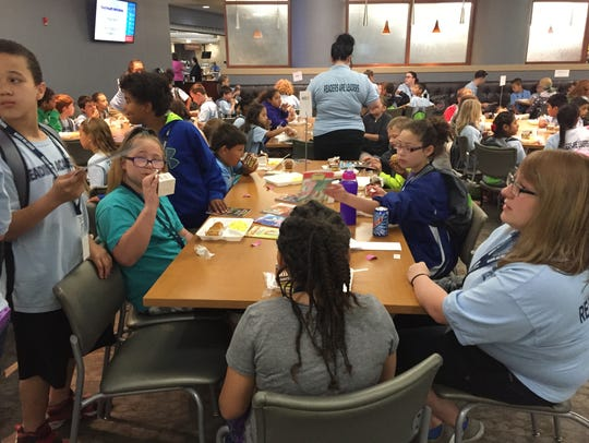 Third Grade Academy students eat breakfast Friday at