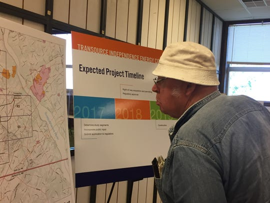 William Kilgore, of Lower Chanceford Townshp, examines a map showing possible routes for an electricity transmission line through southern York County
