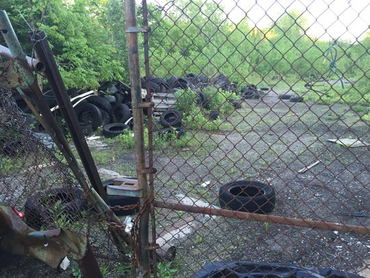 An abandoned junkyard at the former Vacuum Oil site in Rochester.