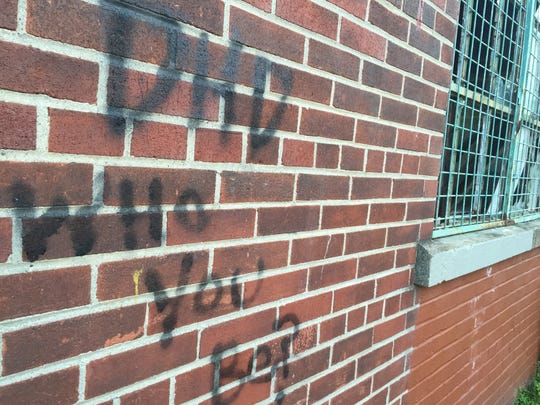 Someone has spray painted a message to one of the property owners of the former Vacuum Oil land.