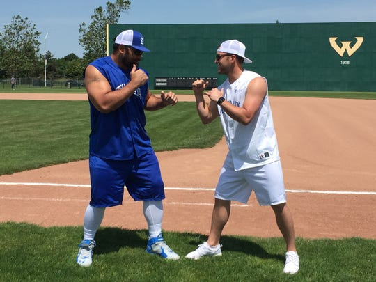 Lions defensive tackle Haloti Ngata, left, and Lions punter Sam Martin at a softball charity game at Wayne State University in Detroit on Saturday, June 10, 2017.
