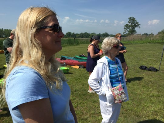 Peggy and Donna Krispin listen during ceremonies to open the Krispin Blueway on Harsens Island.