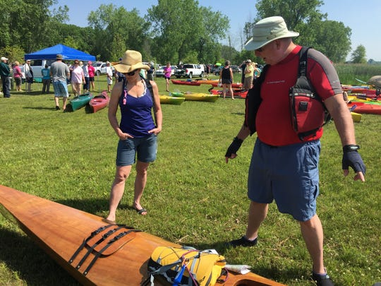 Jerry Celmer, of Port Huron, talks about his hand-crafted kayak with Francine Ignasiak, of Orchard Lake.
