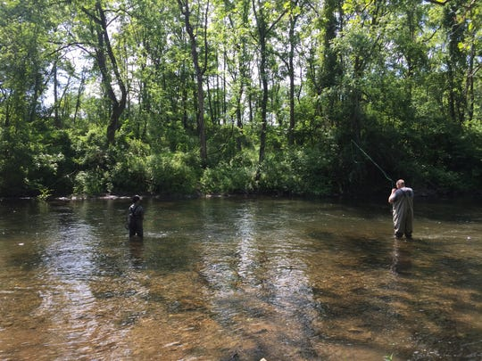 Volunteers and veterans fished the Musconetcong on Saturday.