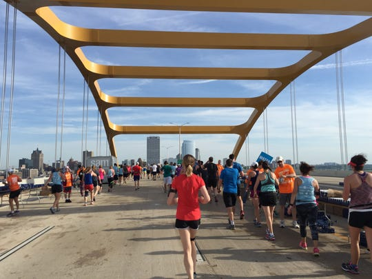 Runners and walkers for the Summerfest Rock 'n Sole get one trip over the Hoan Bridge.